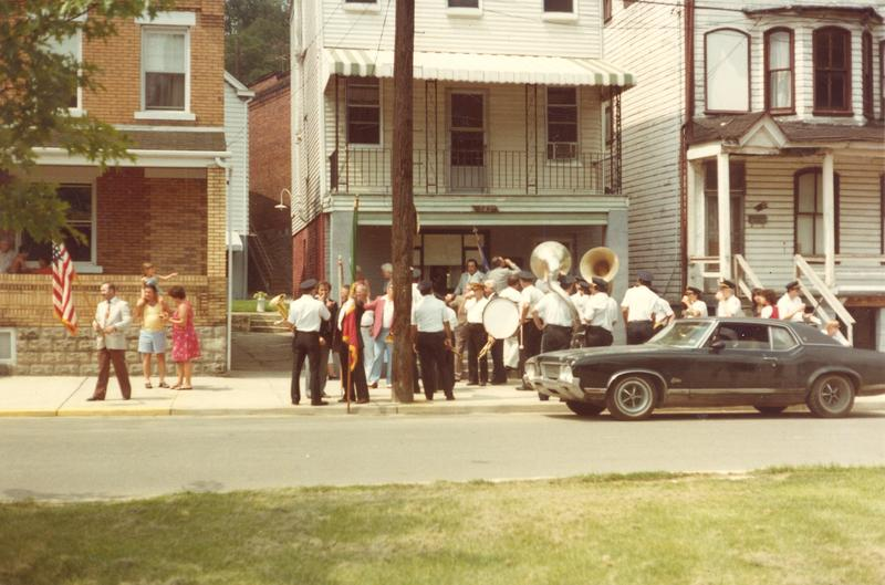 The San Lorenzo band stops in front of 523 Boundary Street. On San Lorenzo's, or Saint Lawrence's, feast day, the band paraded from St. Regis down through the neighborhood.