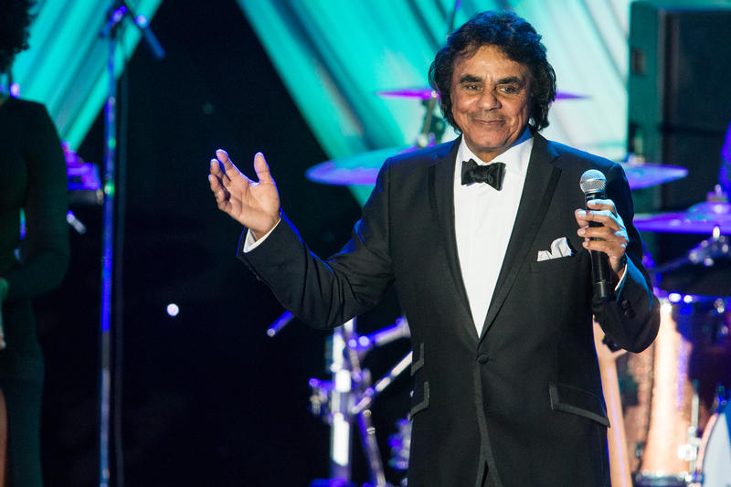 Johnny Mathis performs at the 2015 Clive Davis Pre-Grammy Gala show at the Beverly Hilton Hotel