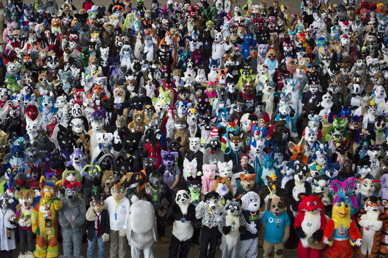 Furries gather for a group photo inside the David L. Lawrence Convention Center.