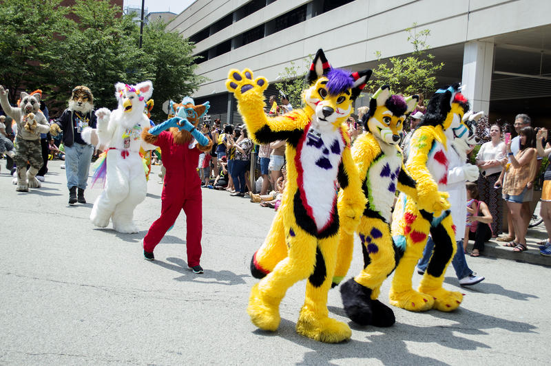 Furries make their way along the parade route Saturday.