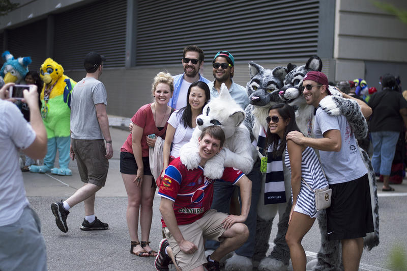 After the parade ended many attendees stayed around to get photos with furries.