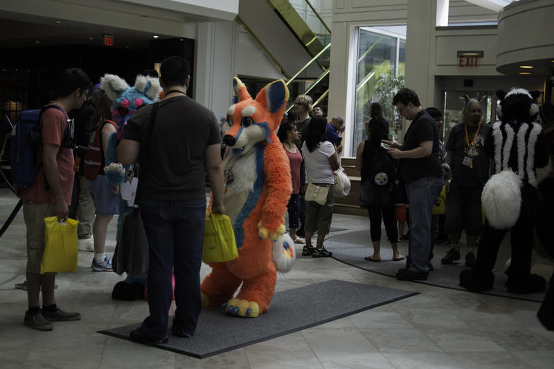 Furries mingle with friends in the main lobby of the Westin Hotel.