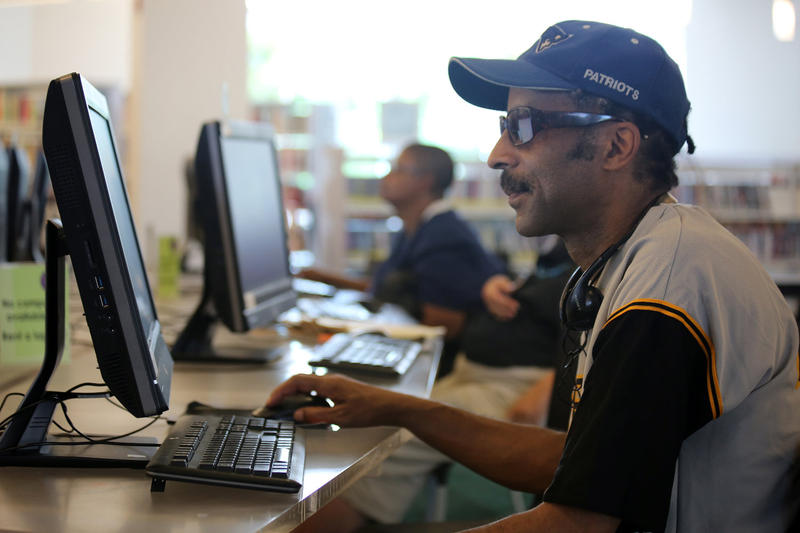 James Allen, 57, uses the computers at the East Liberty branch of the Carnegie Library of Pittsburgh to search for jobs because he doesn't have Internet at home. Here, on June 22, Allen was scouring Craigslist for jobs as a delivery truck driver.