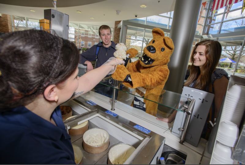 The Nittany Lion receives a cone from the Penn State Creamery.