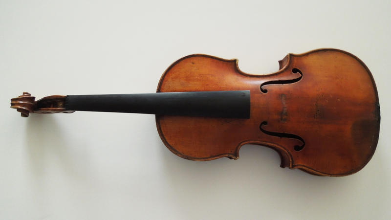 This handout photo provided by the FBI New York shows The Ames Stradivarius which was recovered by the FBI in June.