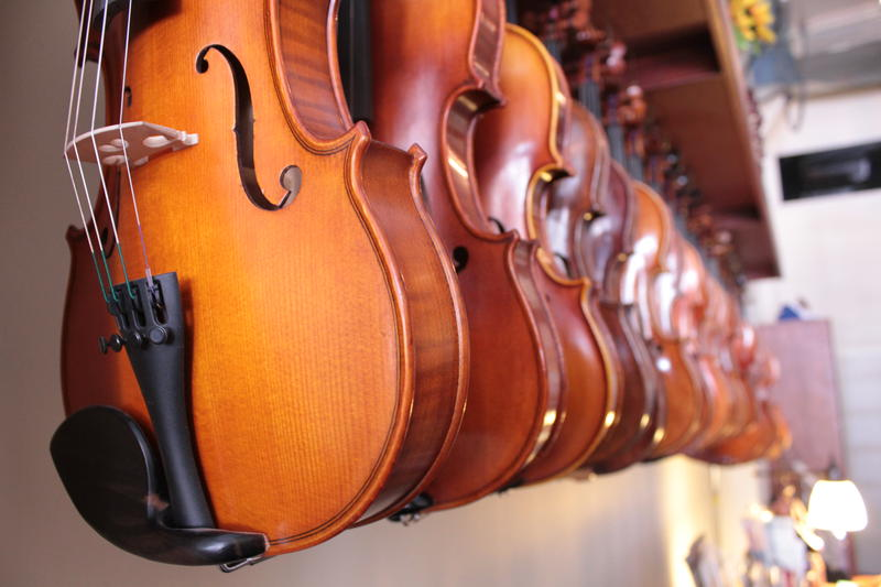 Instruments take pride of place in master violinmaker Phillip Injeian's shop on Penn Avenue.