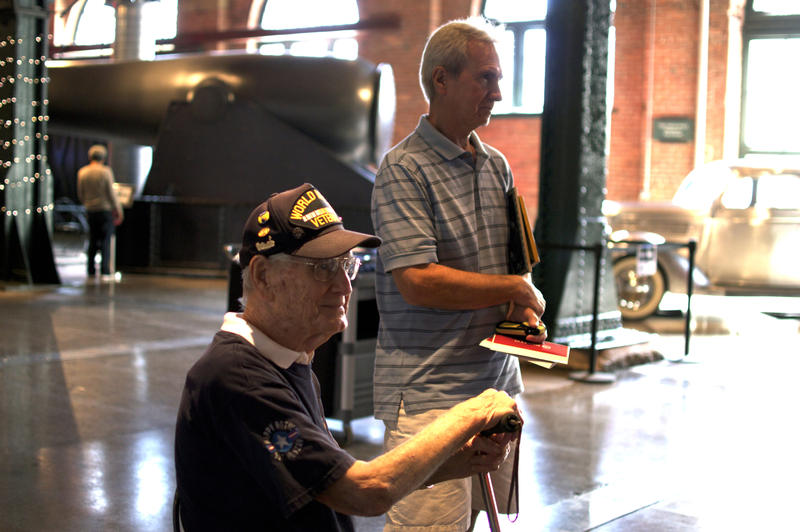 Edward Huzar and his son, Carl, look on as guests enter the WWII exhibit at the Heinz History Center.