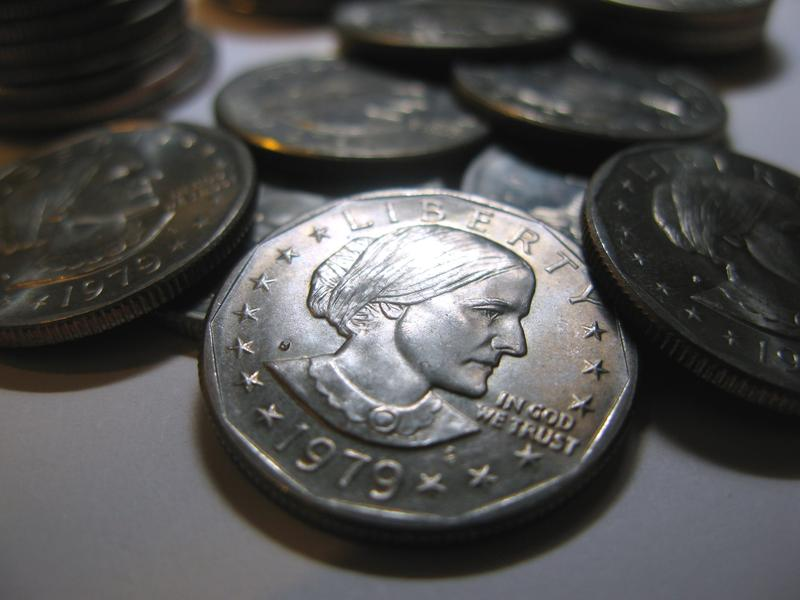 The face of Susan B. Anthony appears on a dollar coin. The coin was printed between