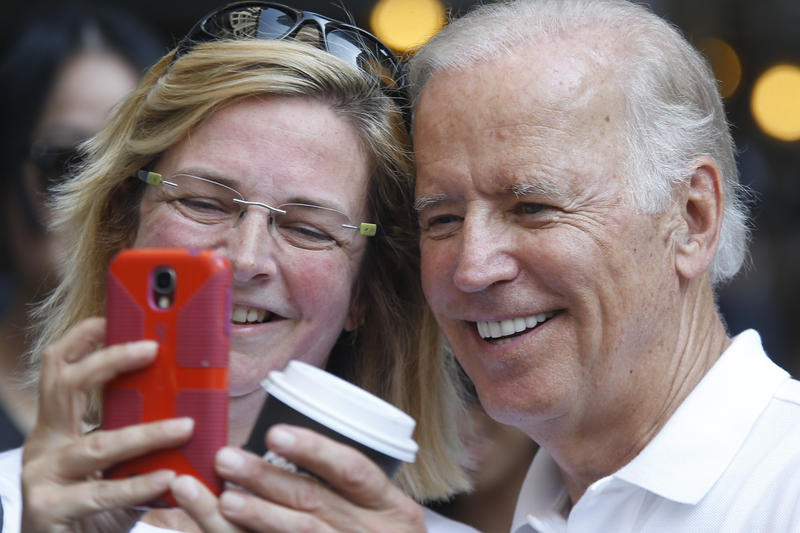 Biden poses for pictures at Pittsburgh's Labor Day parade.