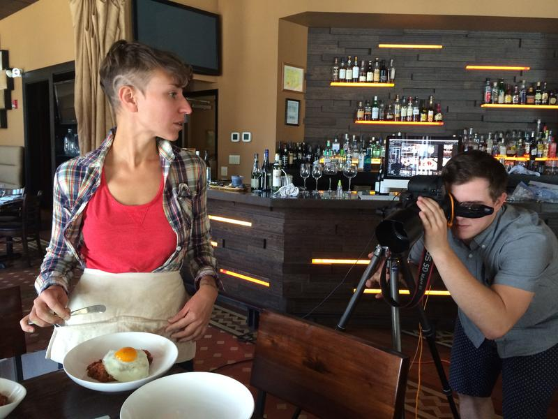 Quelcy Kogel arranges food as Adam Milliron checks the shot.
