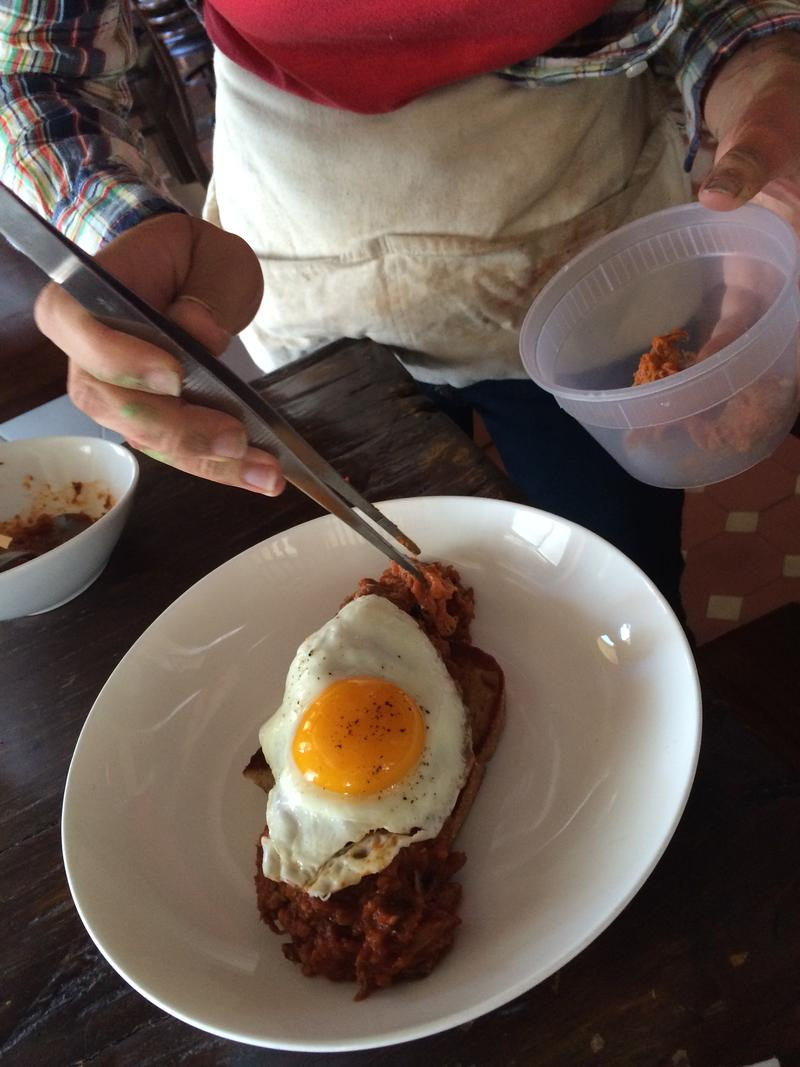 Quelcy Kogel adds ragout to the dish.