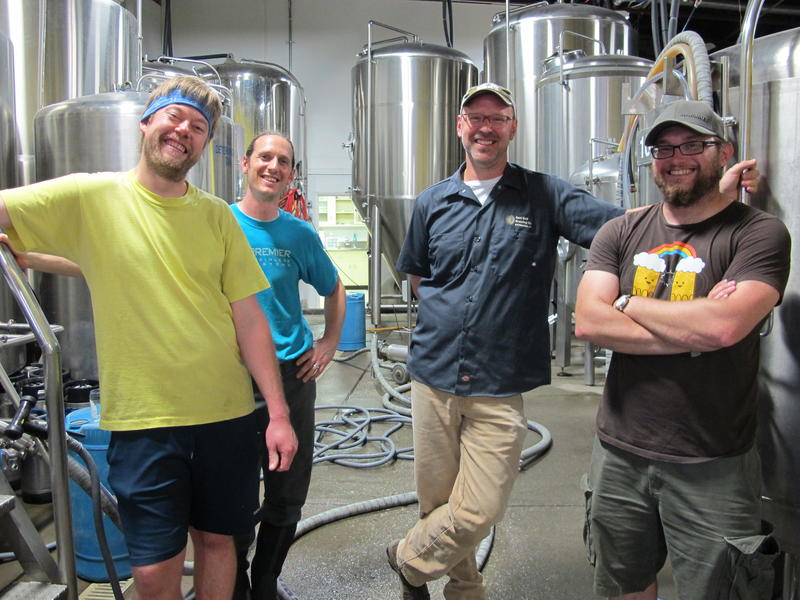 (From left to right) East End Brewing Company brewers Nordy Siljander, Joe Green, owner Scott Smith, and Blue Canoe Brewery head brewer Justin Dudek.