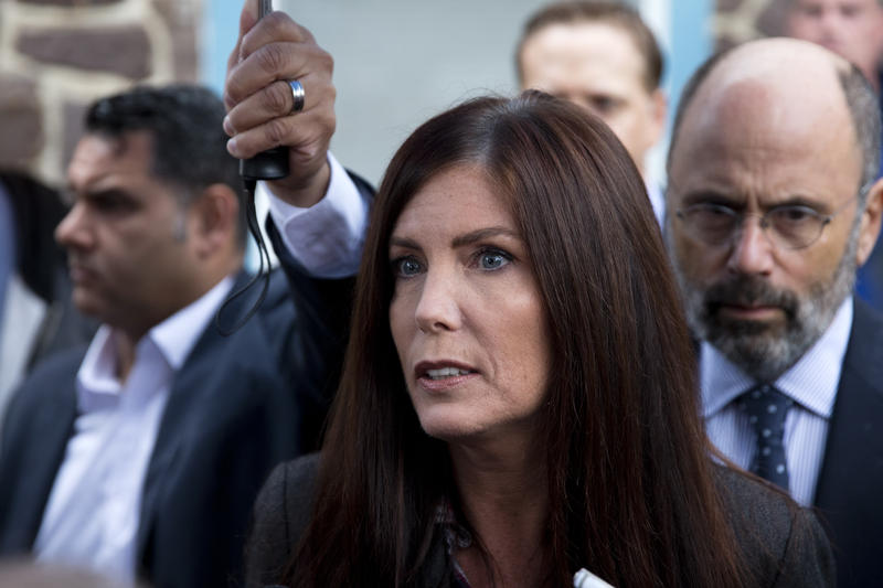 Pennsylvania Attorney General Kathleen Kane speaks with members of the media after her arrangement before a district judge, Thursday, Oct. 1, 2015.