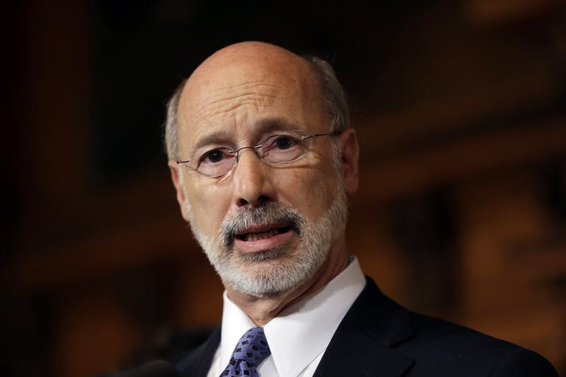 Pennsylvania Gov. Tom Wolf speaks with members of the media earlier this month at the state Capitol in Harrisburg, Pa.