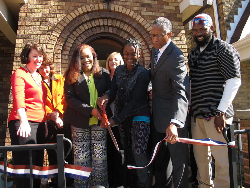 Nadine Nowlin (3rd from left) cuts the ribbon outside the newest Project Journey for Women home in Crafton Heights Monday morning.
