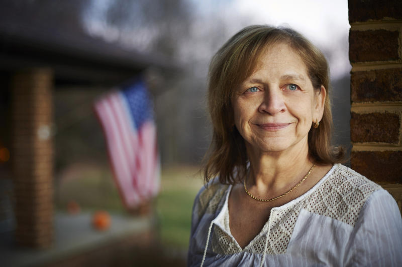 Janet Hoover stands on her front porch in Colver, Pa. The village, about 75 miles east of Pittsburgh, has been mining coal for more than a hundred years and is smack dam in the middle of the sixth most productive coal region in the United States.