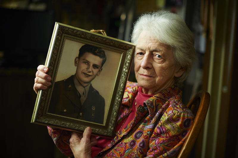 Genie Semko holds a portrait of her husband, George, in his Army Rangers uniform. When he came home from WWII, he went to work in the mines.