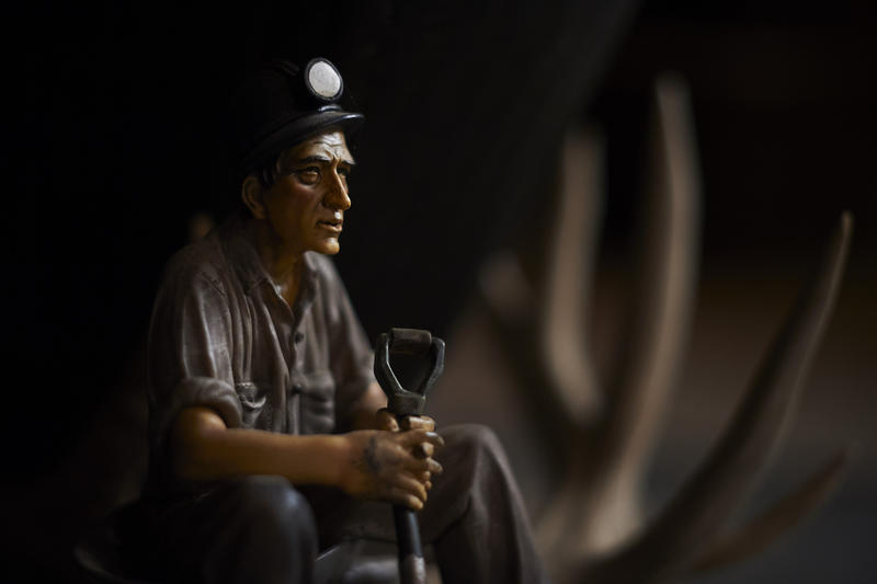 A small miner figurine sits on the hearth in the Beltowski home.