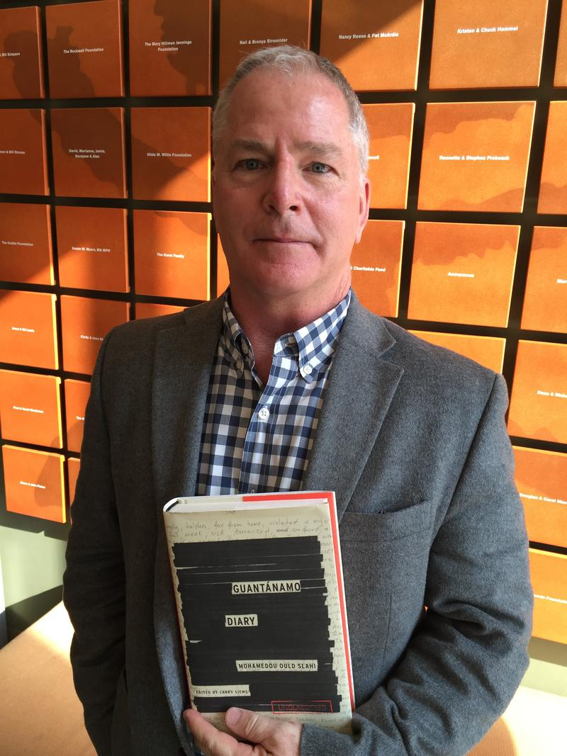 "Editor Larry Siems holds his copy of ""Guantanamo Diary,"" written by Mohamedou Slahi."