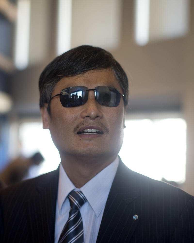 Chinese activist Chen Guangcheng talks with colleagues before speaking at the National Press Club in Washington in 2013.