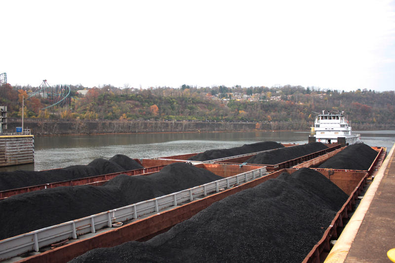 A towboat pushes six 1,500-ton barges of coal upstream through the large chamber at Braddock Locks & Dam.