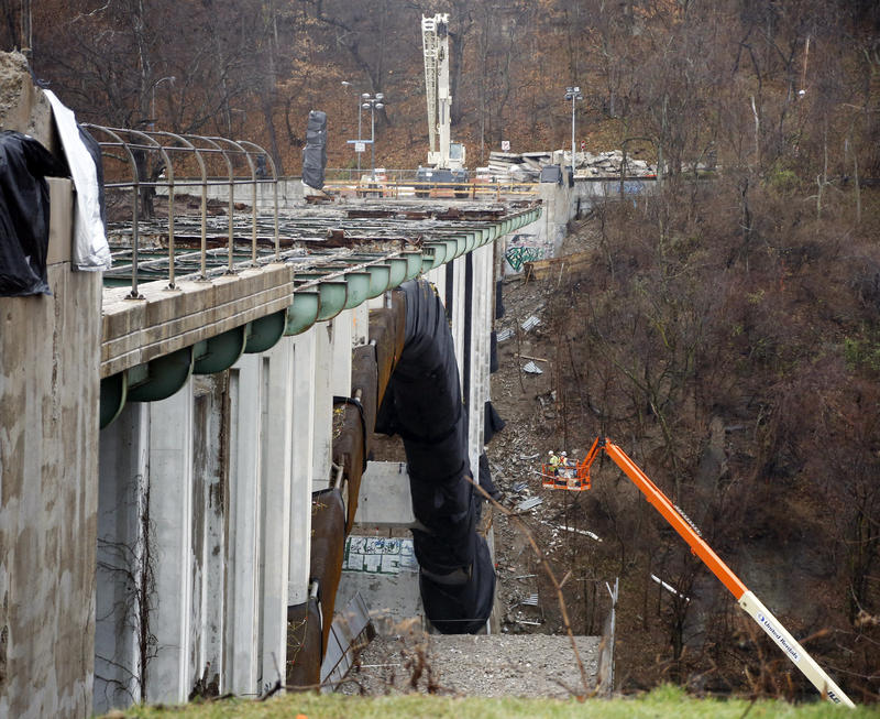 Workers on a lift prepare for the upcoming implosion of Pittsburgh's Greenfield Bridge on Sunday, Dec. 27, 2015. Construction prompted a five-day closure of the city's Parkway East, an artery of Interstate 376.