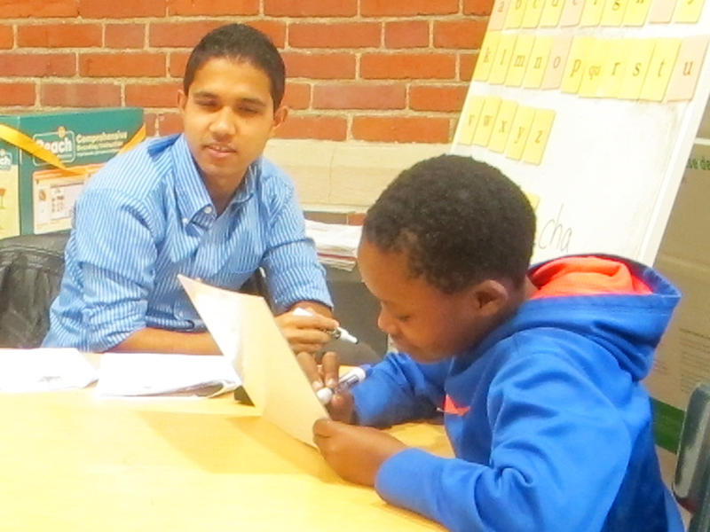 ESL Educational Assistant Jason Bhandari works with student Gabriel Sahij.