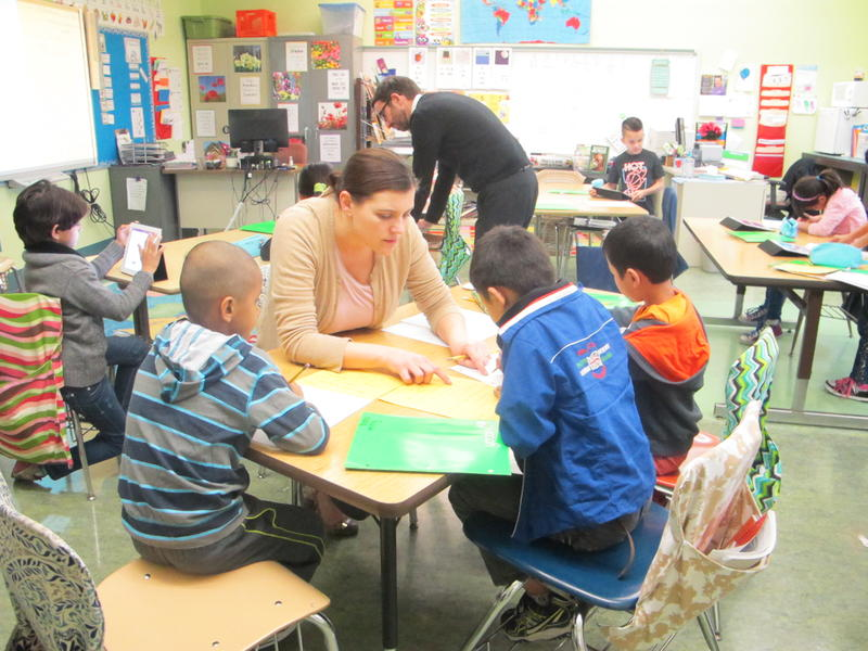 Third and fourth grade teacher Amanda Brown works with students.