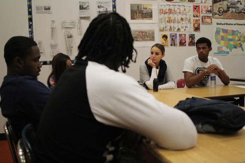 Alexa Tokarski, center, a Learning Environment Specialist at Brashear High School talks to students during an informal circle discussion.