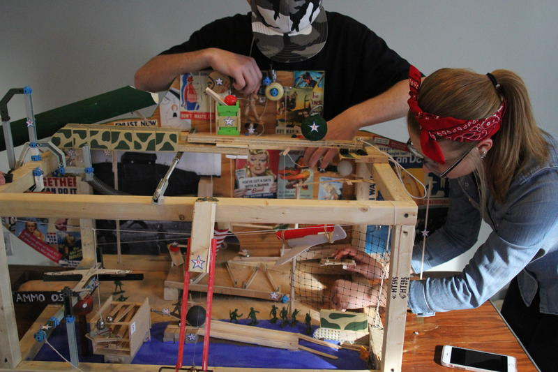 Olivia Piccolo, right, a junior at Cornell High School, and Ryan Dinell, a senior, set up their contraption Friday.