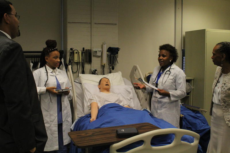 Shakihya Ruffin, second from right, and MiRaya Lucas, tell Pittsburgh Public Schools Superintendent Linda Lane, right, and U.S. Deputy Secretary of Education John King Jr., left, what they have learned in their Health Careers Technology course.