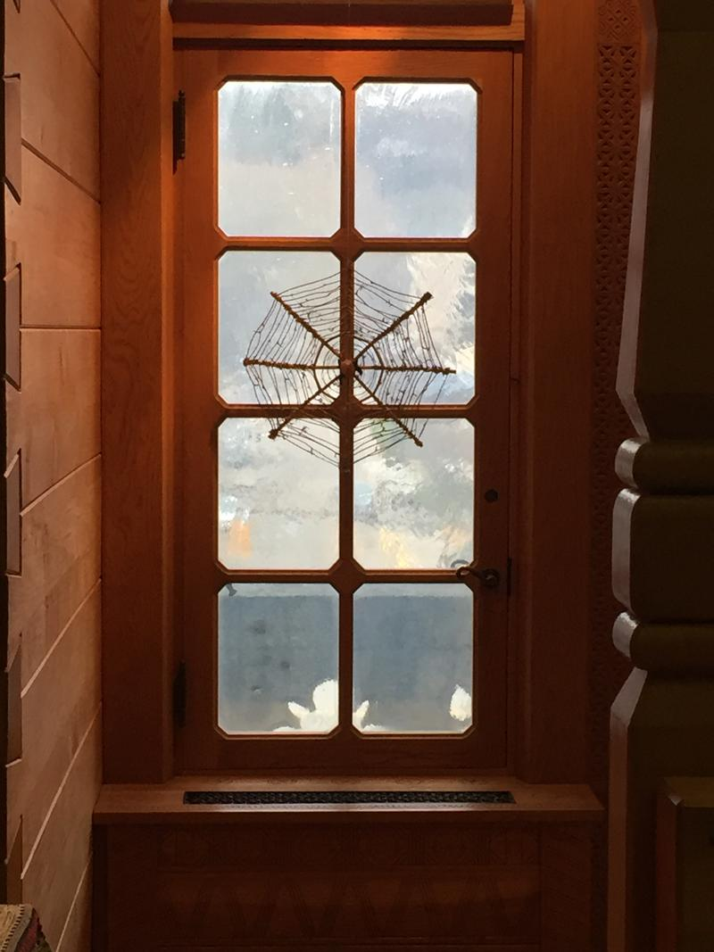 A spider web on the window of the Ukranian Room.