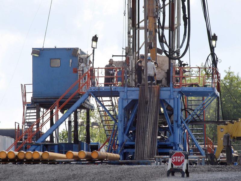 A crew works on a gas drilling rig at a well site near Zelienople, Pa.