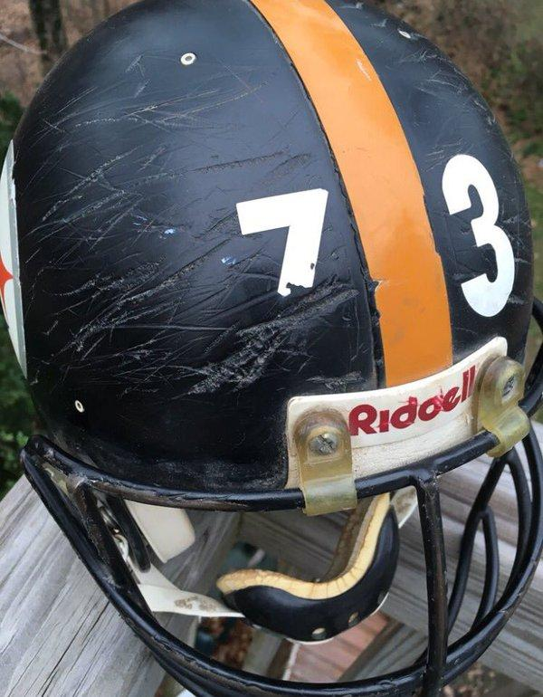 The helmet of late Steelers center Justin Strzelczyk, which his former wife says was not replaced during his nine years of play.