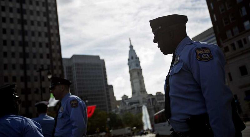 Police stand along Benjamin Franklin Parkway, near City Hall, while Pope Francis visited Philadelphia. Volatile markets could mean trouble for municipal pension funds and, ultimately, taxpayers would be on the hook to make up for low returns.