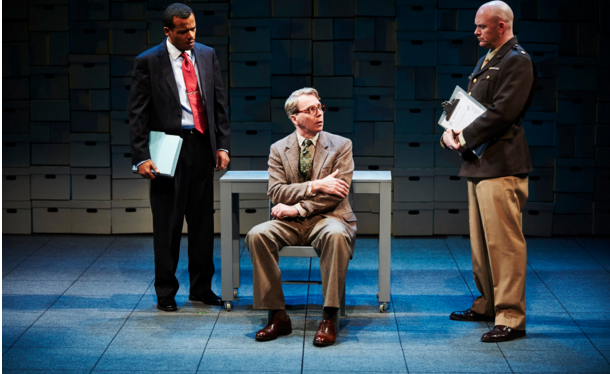 German rocket scientist Arthur Rudolph (Jonathan Tindle) is questioned on his associations with Nazi criminals by Robert Davis (LeRoy McClain) and Major Turner (Matthew Stocke).