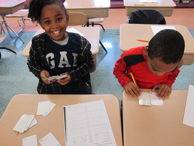 2nd graders Destiney Robinson and Isaiah Muhammad play a card game to practice inequalities in Mr. Dudczak's class.