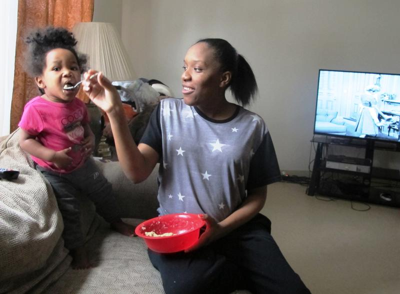 Aseia Glover feeds her daughter Sonja breakfast at their North Side home.
