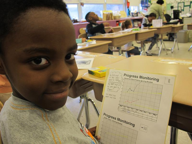 First grader DreAir Mack shows off his high scores for knowing letter sounds in Mrs. Reddick's class at Sunnyside Elementary.