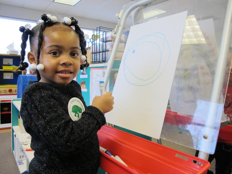 Milania Porter draws with markers at the YWCA Homewood-Brushton Early Childhood Development and Education Center.