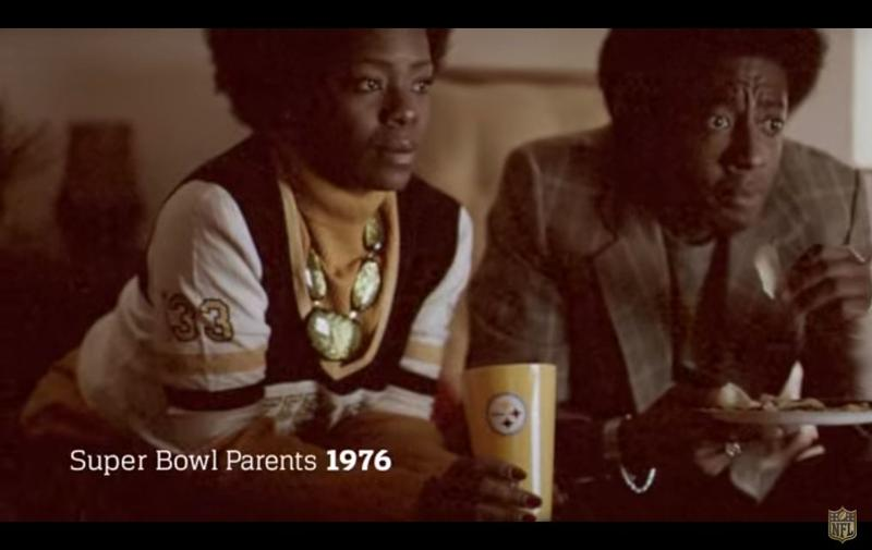 "A still from the ""Super Bowl Babies Choir"" features dramatizations of parents celebrating Super Bowl wins nine months before their children were born. Seal and the NFL teamed up for the advertisement leading up to Super Bowl 50."