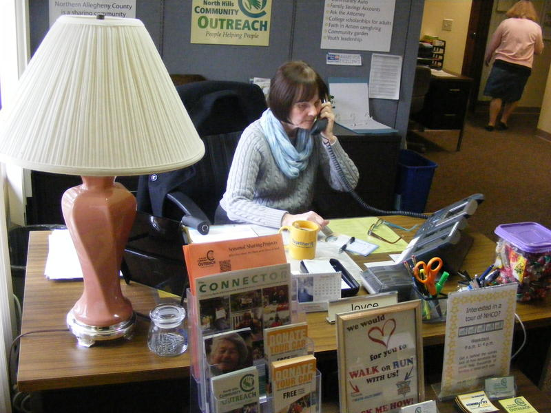 Joyce Rabinovitz answers phones and greets visitors at the North Hills Community Outreach main office.  It is just one of several volunteer positions she holds.
