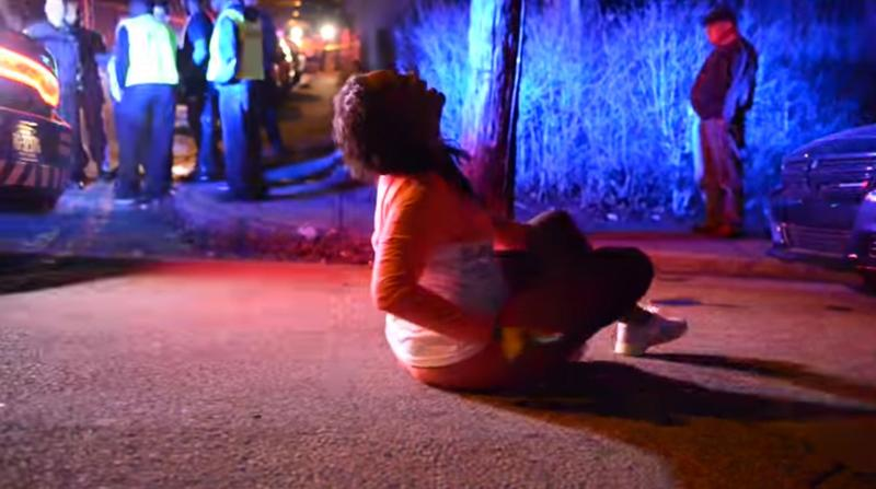 A woman collapses in grief in a still from a video taken at a deadly shooting in Wilkinsburg on Thursday, March 10, 2016. The shooting at a backyard party killed and injured multiple people late Wednesday night.