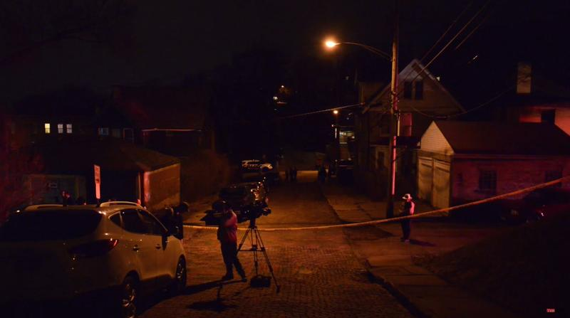 In a still from a video taken early Thursday, March 10, 2016, police lines surround the Wilkinsburg neighborhood where at least two shooters ambushed a backyard party killing and wounding multiple people.