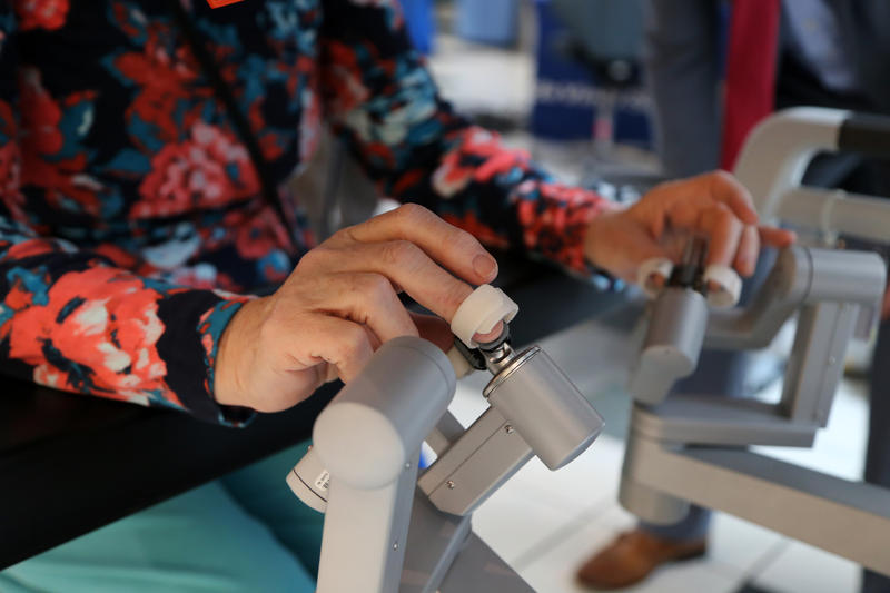 Carolyn Cornell Holland, 72, of Ligonier manipulates the DaVinci Surgery Robot by making micromovements with her fingers. Technicians explained the new technology at the Westmoreland Mall on Thursday, March 24, 2016.