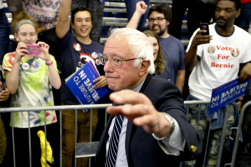 Democratic presidential candidate Sen. Bernie Sanders, I-Vt., waves as he leaves a campaign rally at Fitzgerald Fieldhouse on the University of Pittsburgh campus Monday, April 15, 2016, in Pittsburgh.