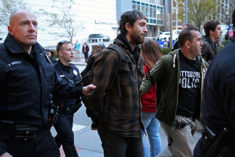Police arrested three people in the protests outside David L. Lawrence Convention Center in Downtown Pittsburgh on Wednesday, April 13, 2016.