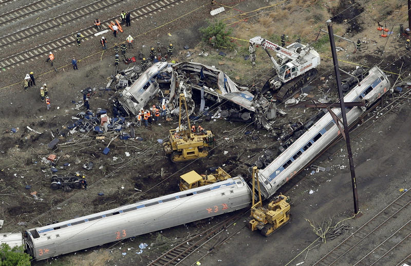 Emergency personnel work at the scene of the 2015 derailment in Philadelphia of an Amtrak train headed to New York. The National Transportation Safety Board is scheduled to release the findings of their investigation.