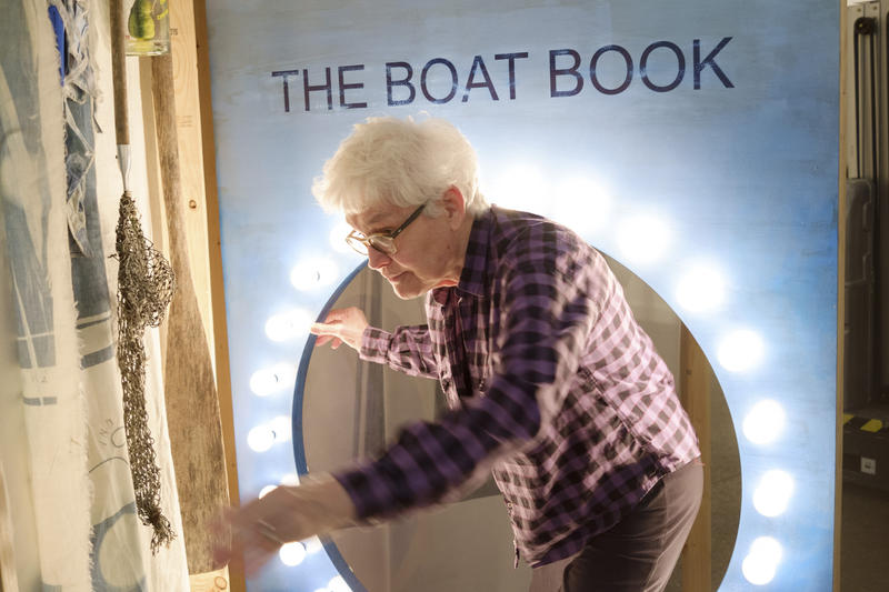 Artist Alison Knowles steps through a 'page' of her 2014 work The Boat Book, which was inspired by her brother, a fisherman.