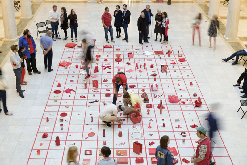 Visitors peruse through various red objects during Celebration Red, an interactive art exhibit by Alison Knowles at the Carnegie Museum of Art on Thursday, May 19, 2016. The event also marked the opening of the artist's retrospective exhibition.